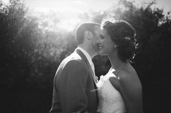 beautiful light groom kissing bride via 32 Secrets Wedding Photographers Wish You Knew
