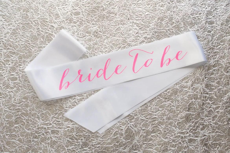bride to be sash hot pink on white | stylish bachelorette sash ideas | via http://emmalinebride.com/bride/bachelorette-sash-ideas/
