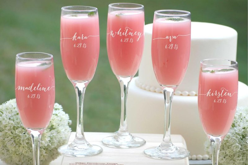 bridesmaid champagne flutes via personalized glassware gifts | http://emmalinebride.com/bridesmaids/personalized-glassware-gifts/