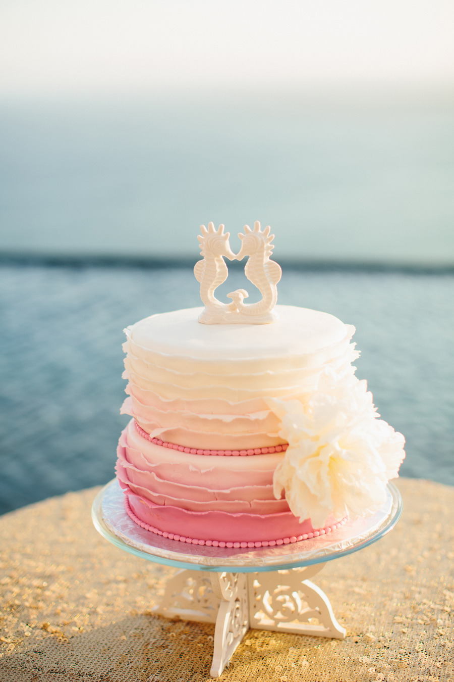 cake with seahorse topper | photo: sara & rocky | via emmalinebride.com
