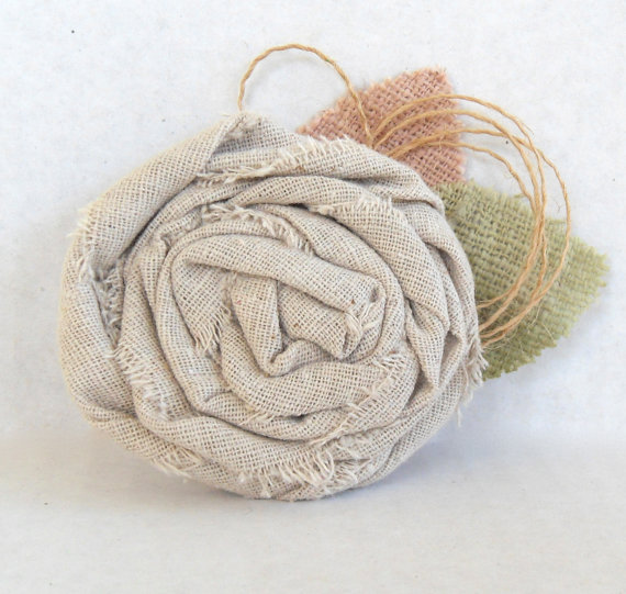 fabric flower pin | via What Kind of Boutonniere to Pick (and Why) http://emmalinebride.com/groom/what-kind-of-boutonniere/
