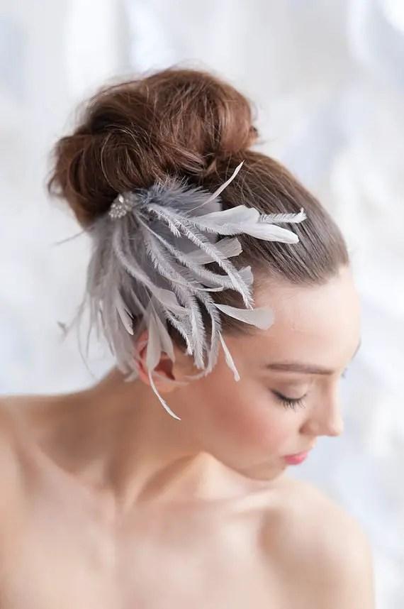 feather fascinator via 15 Stunning Wedding Veil Alternatives