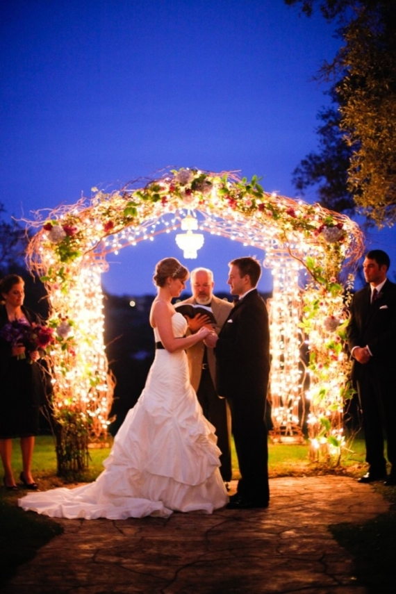 floral lighted arbor - night wedding ideas for ceremony