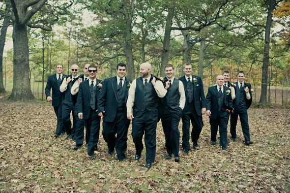 Vintage Fall Wedding - groom and groomsmen standing in woods
