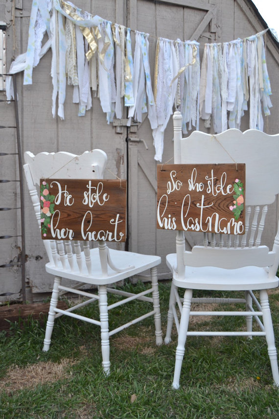 he stole her heart chair signs | via bride and groom chair signs http://emmalinebride.com/decor/bride-and-groom-chairs/