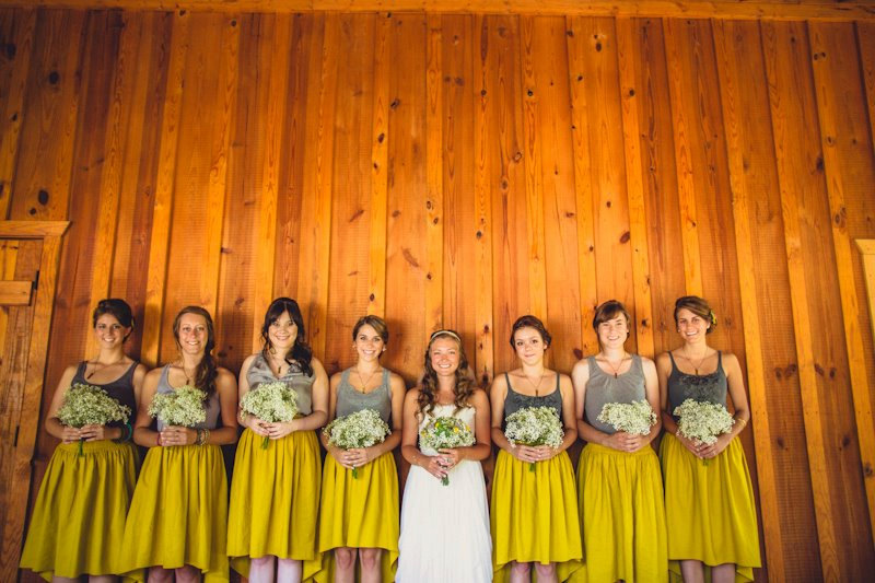 These bridesmaid skirts feature a hi low hem and are available in a variety of colors.  These mustard yellow ones are my favorite! | http://emmalinebride.com/bridesmaids/bridesmaid-skirts-hi-low-hem/