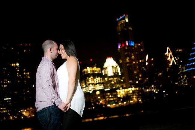 couple under the city skyline at their Fun Austin Engagement Session | Photographer: Adrianne Riley Photography | via http://emmalinebride.com/real-weddings/fun-austin-engagement-session-priscella-jerry/