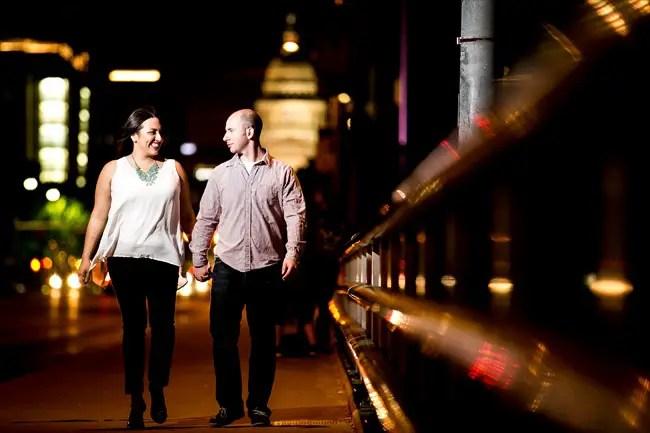 couple walks along bridge at their Fun Austin Engagement Session | Photographer: Adrianne Riley Photography | via http://emmalinebride.com/real-weddings/fun-austin-engagement-session-priscella-jerry/