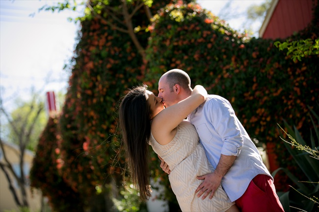 engaged couple kisses at their Fun Austin Engagement Session | Photographer: Adrianne Riley Photography | via http://emmalinebride.com/real-weddings/fun-austin-engagement-session-priscella-jerry/