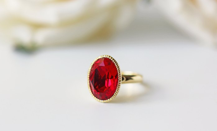 red and gold ring by kaorikaori | via emmalinebride.com