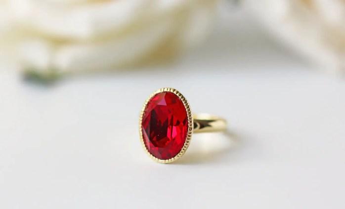 red and gold ring by kaorikaori   via emmalinebride.com