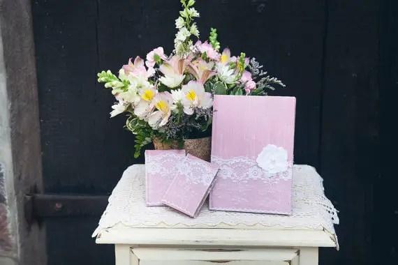 8 Fresh Rustic Wedding Decor Ideas - lace wrapped vow books (by PNZ Designs, photo: Melania Marta Photography)