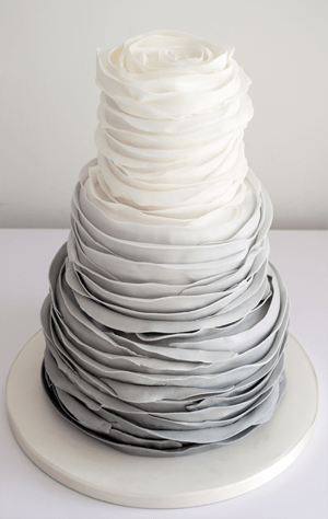 layered wedding cake with ombre design