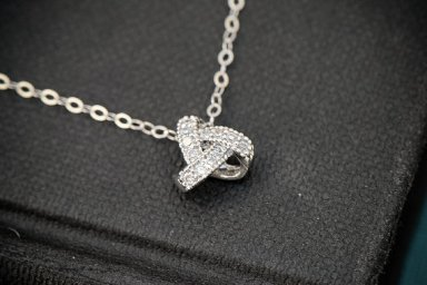 love knot necklace by silver lotus designs   via emmalinebride.com