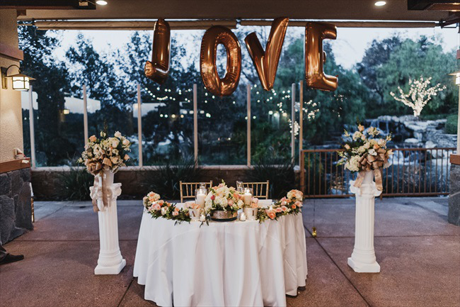 love wedding sweetheart table