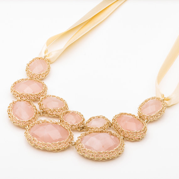 pink statement necklace (via How to Wear a Bib Necklace)