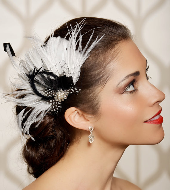 polka dot feather fascinator | via polka dot wedding ideas http://emmalinebride.com/themes/polka-dot-wedding-ideas-handmade/