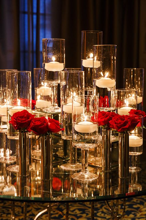 red rose centerpiece with votives