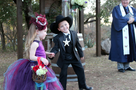 ring bearer wearing a badge