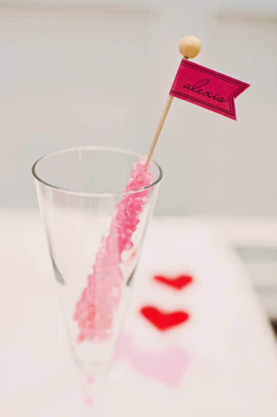 Rock candy place cards are a fun idea your guests will love. Add a name flag to the candy stick with a bit of glue.