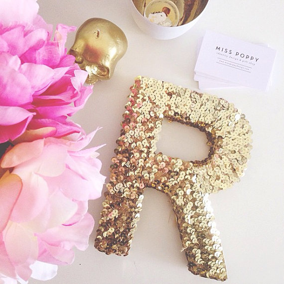 sequin letter in gold