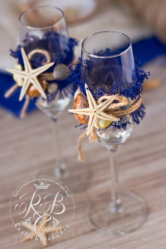starfish champagne flutes | via starfish wedding ideas: http://emmalinebride.com/beach/starfish-wedding-ideas/