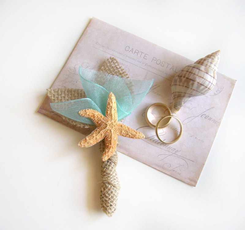 starfish boutonniere | via starfish wedding ideas: http://emmalinebride.com/beach/starfish-wedding-ideas/