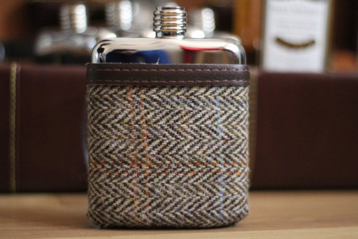swig flask covered in tweet pouch