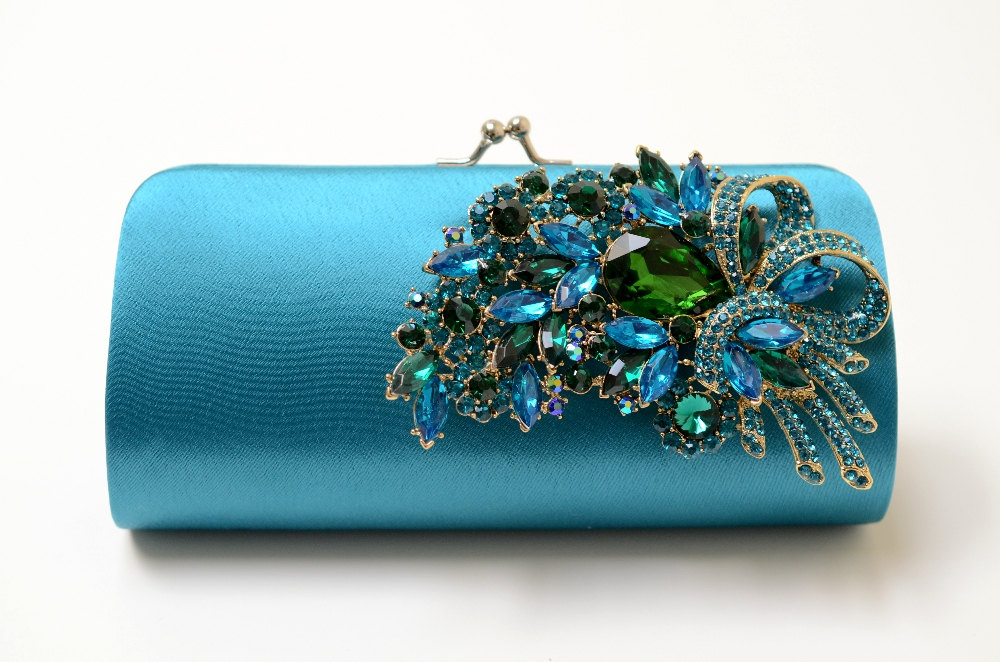 teal clutch with peacock brooch