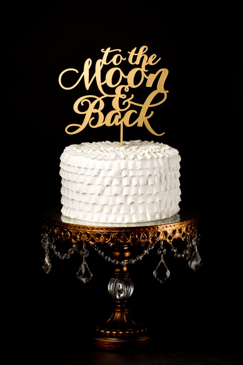 to the moon and back   cake toppers via http://emmalinebride.com/decor/statement-cake-toppers/