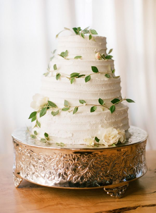 wedding cake accented with leaves