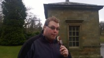 Cameron enjoying an ice cream in the freezing wind at Studley Royal!