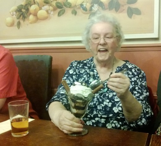 Grandma enjoying her huge ice cream sundae