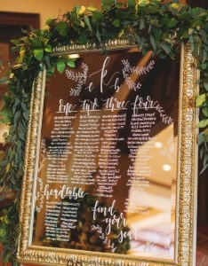 Mirror wedding seating chart sign features hand calligraphy also rh emmalovesweddings