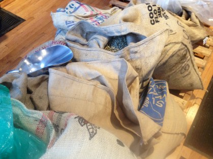Large bags of raw coffee beans are imported each week to be used for roasting.