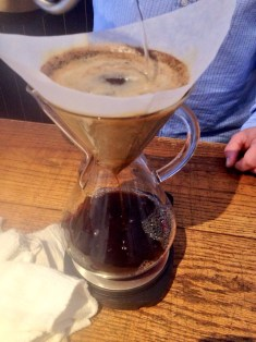 Owner Jesse Harriott brews a signature espresso blend.