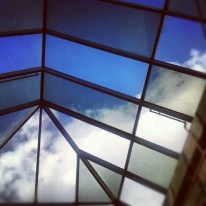 clouds through the roof of the bus depot in toronto.