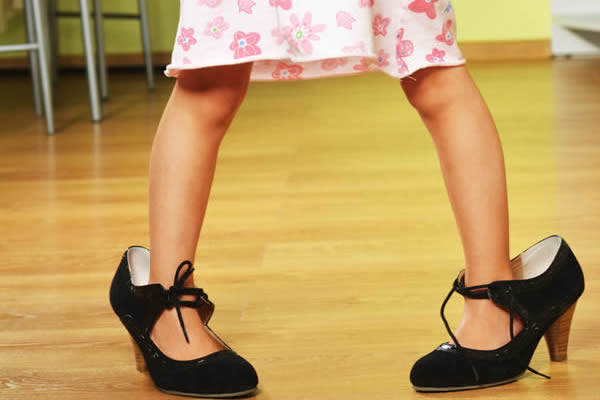 child in adult shoe- fitting kid's shoes