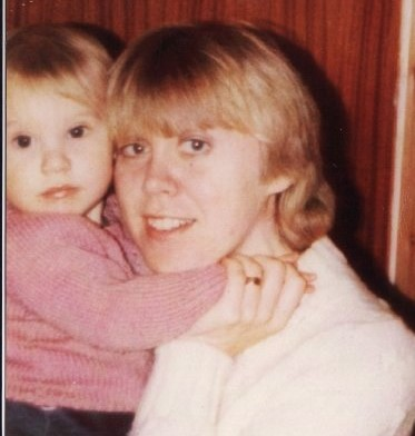 Mum holding me as a child