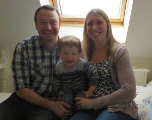 family smiling for social media article