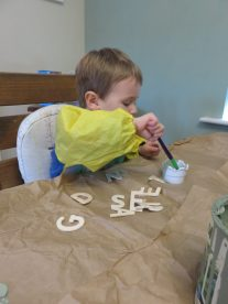 Jake painting the letters