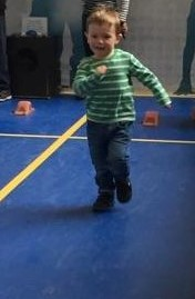 Jake running at the science centre on our day out