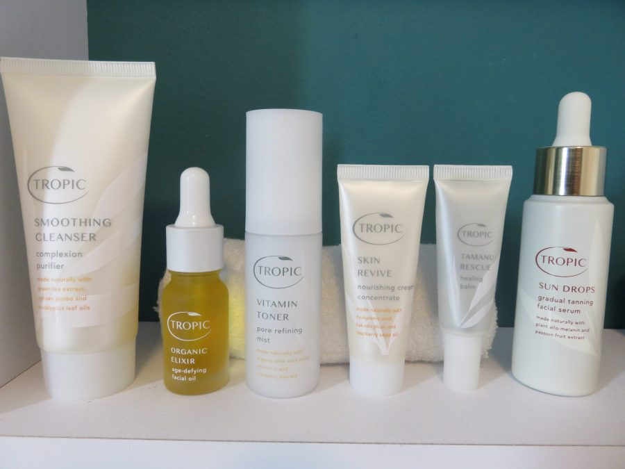 Tropic Skincare products on a white shelf