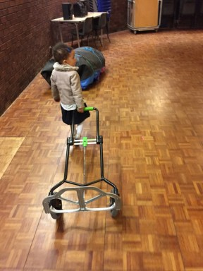 child pulling a trolley