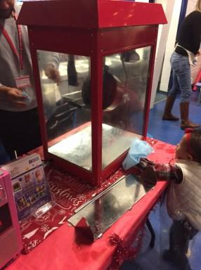 child cleaning the popcorn machine