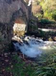 water running under a bridge