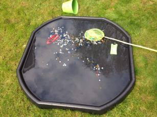 tuff tray with water and net