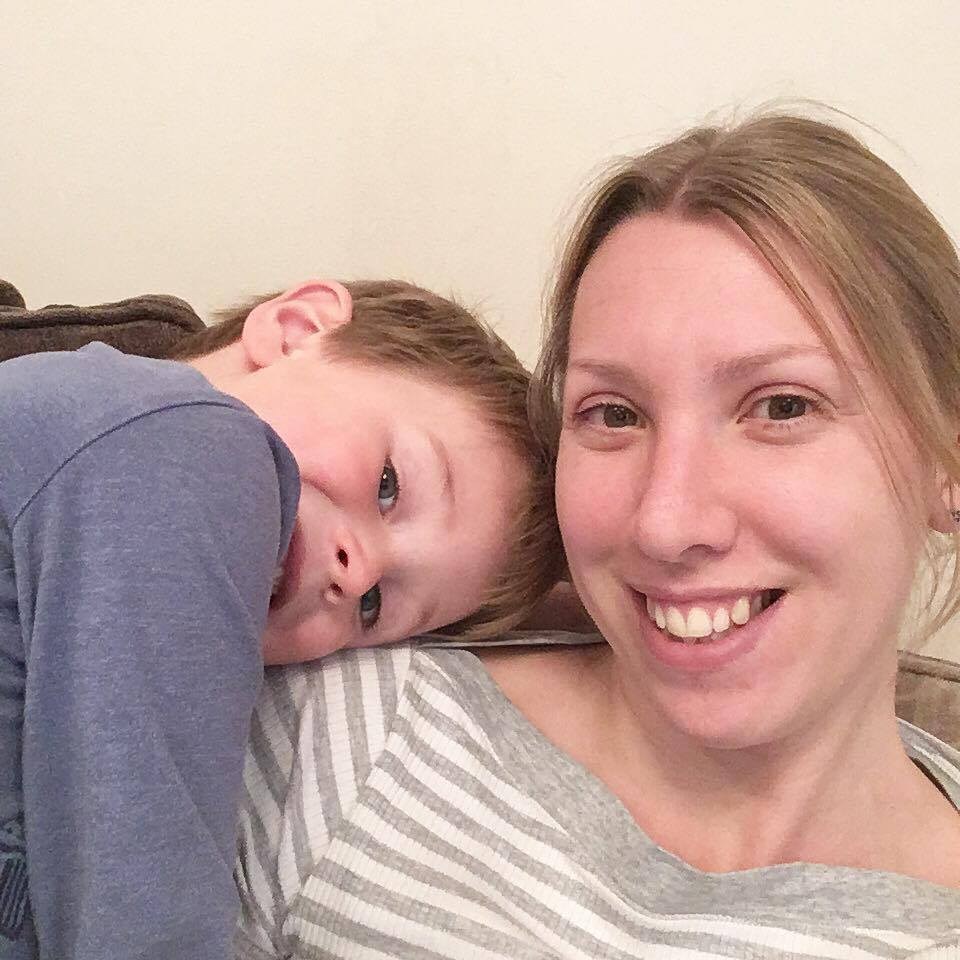 child with head on mummy's shoulder