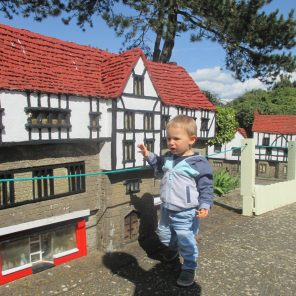 child in miniature village