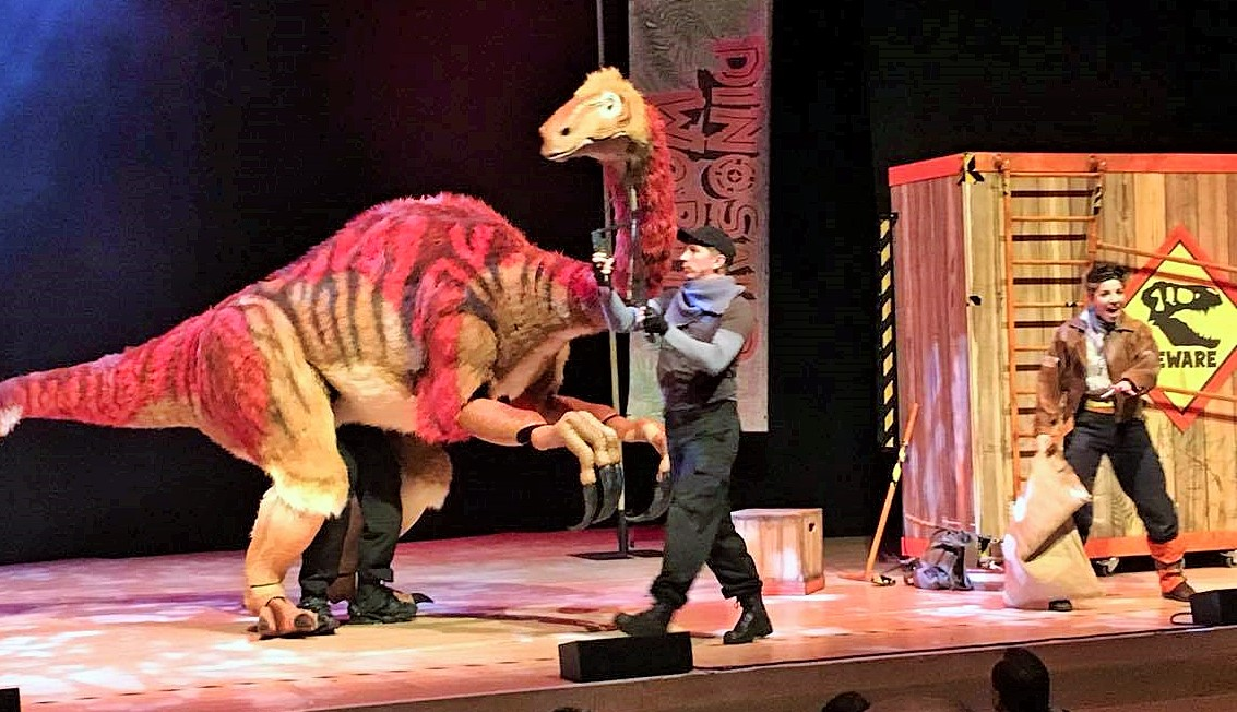 red sinosaur and puppeteer